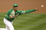 Oakland Athletics pitcher Sean Manaea works against the Texas Rangers in the first inning of a baseball game Wednesday, Aug. 5, 2020, in Oakland, Calif. (AP Photo/Ben Margot)