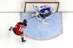 New Jersey Devils right wing Drew Stafford (18) scores a goal against St. Louis Blues goaltender Jake Allen (34) during the second period of an NHL hockey game, Saturday, March 30, 2019, in Newark, N.J. (AP Photo/Julio Cortez)
