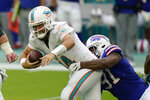 Buffalo Bills defensive tackle Ed Oliver (91) sacks Miami Dolphins quarterback Ryan Fitzpatrick (14)during the first half of an NFL football game, Sunday, Sept. 20, 2020 in Miami Gardens, Fla. (AP Photo/Wilfredo Lee)