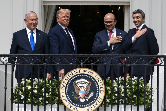 FILE - In this Tuesday, Sept. 15, 2020 file photo, Israeli Prime Minister Benjamin Netanyahu, left, President Donald Trump, Bahrain Foreign Minister Khalid bin Ahmed Al Khalifa and United Arab Emirates Foreign Minister Abdullah bin Zayed al-Nahyan react on the Blue Room Balcony after signing the Abraham Accords during a ceremony on the South Lawn of the White House in Washington. Jewish American voters have leaned Democratic for decades, but the GOP is still eyeing modest gains with the constituency in states where President Donald Trump could reap major benefits with even small improvements over his performance in 2016. (AP Photo/Alex Brandon)