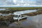 A vehicle is submerged in floodwater after it got swept away by Cyclone Idai in Nyamatanda about 50 kilometres from Beira, in Mozambique, Thursday March, 21, 2019.  Some hundreds are dead, many more still missing and thousands at risk from massive flooding across the region including Mozambique, Malawi and Zimbabwe caused by Cyclone Idai.(AP Photo/Tsvangirayi Mukwazhi)