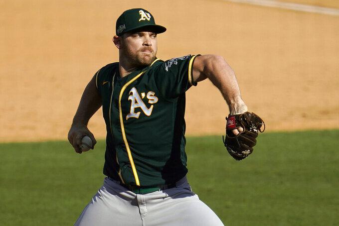 FILE - In this Wednesday, Oct. 7, 2020 file photo, Oakland Athletics pitcher Liam Hendriks throws against the Houston Astros during the ninth inning of Game 3 of a baseball American League Division Series in Los Angeles. Liam Hendriks is taking nothing for granted. The Chicago White Sox's new closer insisted he has to earn the job this spring and he's just another reliever until he does. Except, of course, he's not just another reliever.(AP Photo/Marcio Jose Sanchez, File)