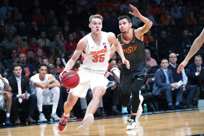 Syracuse guard Buddy Boeheim (35) drives against Oklahoma State guard Thomas Dziagwa (4) during the second half of an NCAA college semi final basketball game in the NIT Season Tip-Off tournament, Wednesday, Nov. 27, 2019, in New York. Oklahoma State won 86-72. (AP Photo/Mary Altaffer)