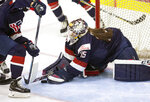 FILE - In this Nov. 7, 2017, file photo, United States goaltender Maddie Rooney makes a save during the second period of the Four Nations Cup hockey game against Finland in Wesley Chapel, Fla. Rooney will be in net for the United States against Finland Sunday, Feb. 11, 2018, in the Americans' Olympic opener in women's hockey. (Loren Elliott/Tampa Bay Times via AP)