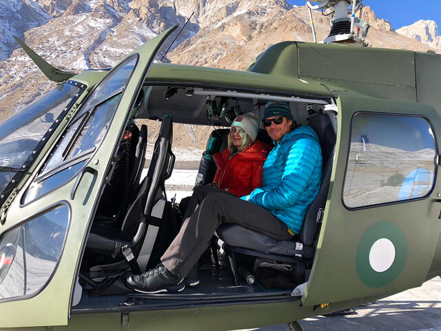 CORRECTS NATIONALITY OF CLIMBER TO CANADIAN --  In this photo released by Inter Services Public Relations of Pakistan's military, rescued mountaineers Donald Allen Bowie from Canada and Lotta Henriikka Nakyva from Finland, sit in a helicopter after being rescued by the Pakistan Army from Broad Peak, Baltoro Glacier in Pakistan, Sunday, Feb. 9, 2020. (Inter Services Public Relations via AP)