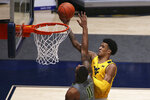 West Virginia forward Jalen Bridges (2) shoots while defended by Baylor guard Mark Vital (11) during the first half of an NCAA college basketball game Tuesday, March 2, 2021, in Morgantown, W.Va. (AP Photo/Kathleen Batten)
