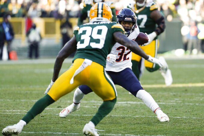 Chicago Bears' David Montgomery tries to run past Green Bay Packers' Chandon Sullivan during the first half of an NFL football game Sunday, Dec. 15, 2019, in Green Bay, Wis. (AP Photo/Matt Ludtke)