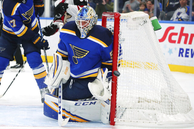 St. Louis Blues goalie Jordan Binnington (50) makes a save against the Arizona Coyotes during the first period of an NHL hockey game Thursday, Feb. 20, 2020, in St. Louis. (AP Photo/Dilip Vishwanat)