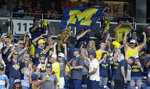 Michigan fans cheer in the stands following the team's NCAA College World Series baseball elimination game against Texas Tech in Omaha, Neb., Friday, June 21, 2019. Michigan won 15-3. (AP Photo/Nati Harnik)