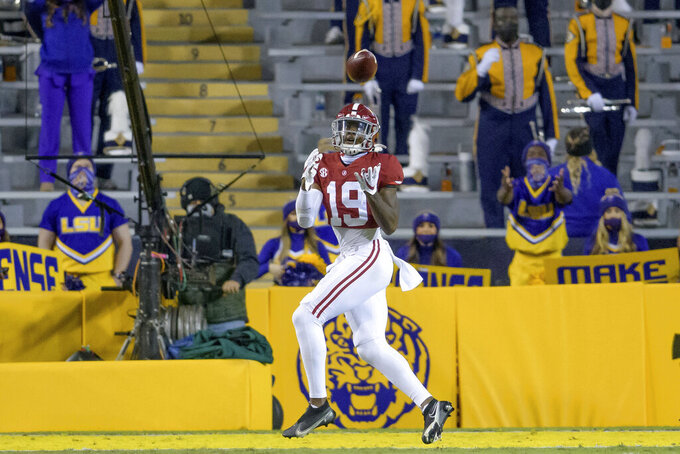 Alabama tight end Jahleel Billingsley (19) scores a touchdown during the first half of an NCAA college football game against LSU in Baton Rouge, La., Saturday, Dec. 5, 2020. (AP Photo/Matthew Hinton)
