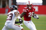 Nebraska running back Maurice Washington (28) carries the ball against Northern Illinois cornerback Jalen McKie (23) during the first half of an NCAA college football game in Lincoln, Neb., Saturday, Sept. 14, 2019. (AP Photo/Nati Harnik)
