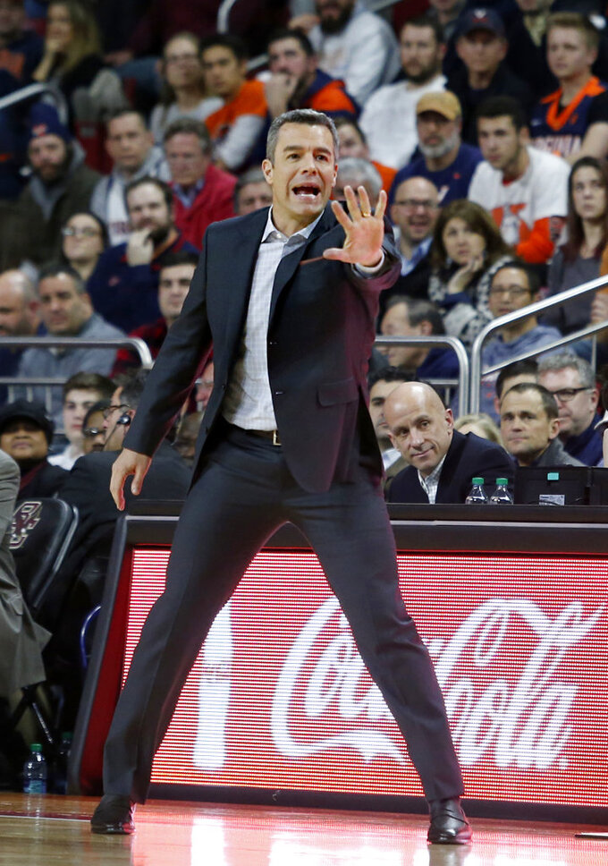 Virginia coach Tony Bennett directs his team during the first half of an NCAA basketball game against Boston College, Wednesday, Jan. 9, 2019, in Boston. (AP Photo/Mary Schwalm)