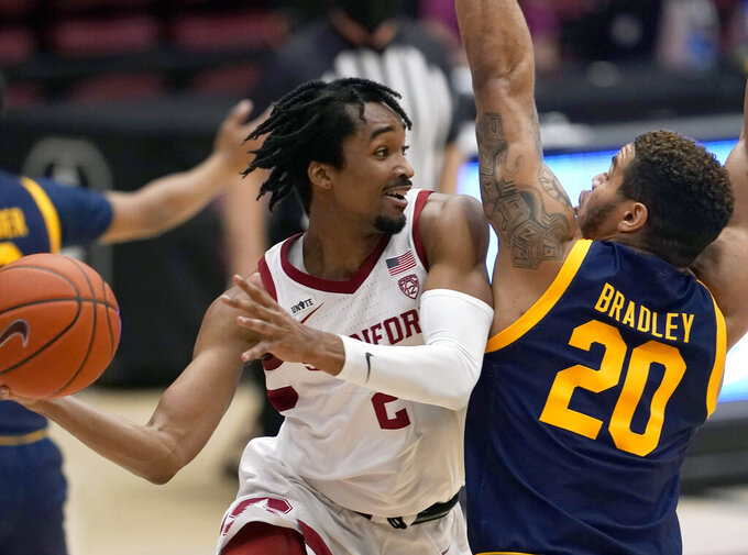 Stanford guard Bryce Wills (2) looks to pass the ball against California guard Matt Bradley (20) during the first half of an NCAA college basketball game in Stanford, Calif., Sunday, Feb. 7, 2021. (AP Photo/Tony Avelar)