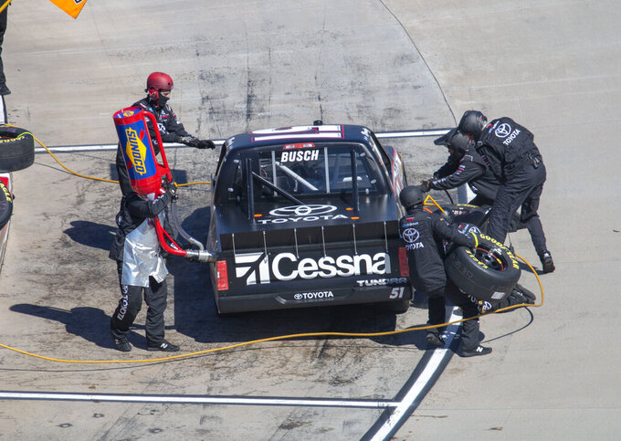 Kyle Busch pits under caution during the NASCAR Truck Series race at Martinsville Speedway in Martinsville, Va. Saturday, March 23. (AP Photo/Matt Bell)