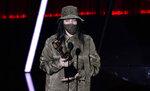 Billie Eilish accepts the award for top Billboard 200 album for