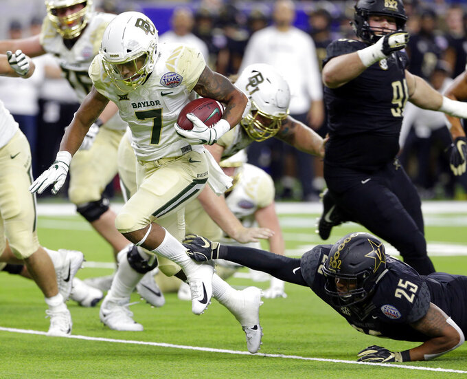 Baylor running back John Lovett (7) slips through the tackle-attempt by Vanderbilt linebacker Josh Smith (25) to score during the first half of the Texas Bowl NCAA college football game Thursday, Dec. 27, 2018, in Houston. (AP Photo/Michael Wyke)