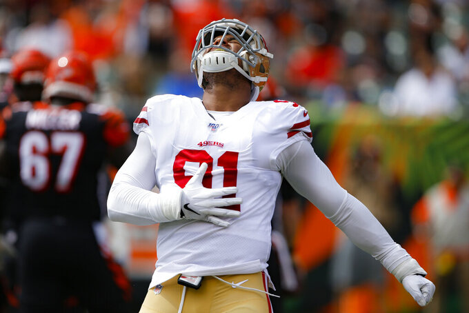 San Francisco 49ers defensive end Arik Armstead (91) reacts after sacking Cincinnati Bengals quarterback Andy Dalton during the first half an NFL football game, Sunday, Sept. 15, 2019, in Cincinnati. (AP Photo/Gary Landers)