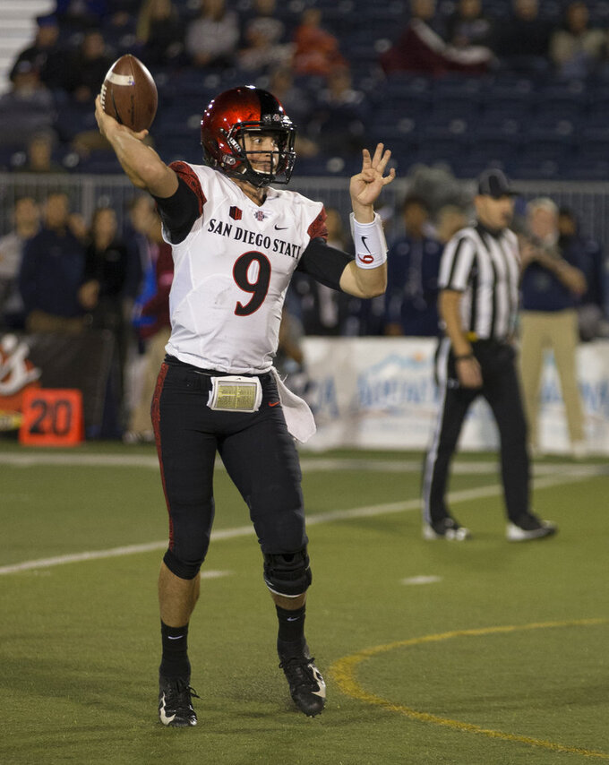 San Diego State quarterback (9) throws a touchdown against Nevada in the first half of an NCAA college football game in Reno, Nev., Saturday, Oct. 27, 2018. (AP Photo/Tom R. Smedes)