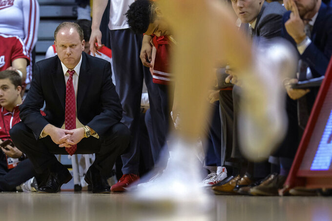 Wisconsin coach Greg Gard watches the team play Indiana during the first half of an NCAA college basketball game in Bloomington, Ind., Tuesday, Feb. 26, 2019. Indiana won 75-73 in double overtime. (AP Photo/AJ Mast)