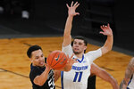 Butler's Jair Bolden, left, passes the ball away from Creighton's Marcus Zegarowski during the second half of an NCAA college basketball game in the Big East men's tournament Thursday, March 11, 2021, in New York. (AP Photo/Frank Franklin II)