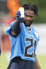 Tennessee Titans cornerback Malcolm Butler (21) takes a drink during NFL football training camp Friday, Aug. 14, 2020, in Nashville, Tenn. (George Walker IV/Pool Photo via AP)