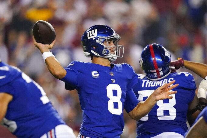 New York Giants quarterback Daniel Jones (8) throws the ball during the first half of an NFL football game against the Washington Football Team, Thursday, Sept. 16, 2021, in Landover, Md. (AP Photo/Alex Brandon)