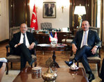 French Foreign Minister Jean-Yves Le Drian, left, and Turkey's Foreign Minister Mevlut Cavusoglu pose for photos before a meeting in Ankara, Turkey, Thursday, June 13, 2019. (Turkish Foreign Ministry via AP, Pool)
