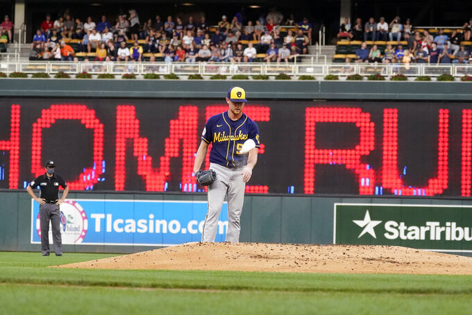 Milwaukee Brewers pitcher Eric Lauer tosses his rosin bag after giving up a two-run home run to Minnesota Twins' Josh Donaldson in the first inning of a baseball game Friday, Aug. 27, 2021, in Minneapolis. (AP Photo/Jim Mone)