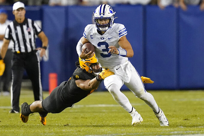BYU quarterback Jaren Hall (3) out runs an Arizona State defender during the second half of an NCAA college football game Saturday, Sept. 18, 2021, in Provo, Utah. (AP Photo/Rick Bowmer)