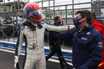 British Formula One driver George Russell of Williams Racing reacts after taking the third position in the qualifying session of the 2021 Formula One Grand Prix of Russia at the Sochi Autodrom race track in Sochi, Russia, Saturday, Sept. 25, 2021. The Russian Formula One Grand Prix will be held on Sunday. (Yuri Kochetkov/Pool Photo via AP)