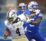 Western Michigan defensive back Patrick Lupro (4) carries the ball while BYU defensive back Dayan Ghanwoloku (5) works to bring him down during the Famous Idaho Potato Bowl NCAA college football game Friday, Dec. 21, 2018, in Boise, Idaho. (Drew Nash/The Times-News via AP)