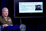 Positive identification information on Abu Bakr al-Baghdadi is displayed as U.S. Central Command Commander Marine Gen. Kenneth McKenzie speaks, Wednesday, Oct. 30, 2019, at a joint press briefing at the Pentagon in Washington. (AP Photo/Andrew Harnik)