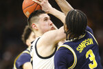 Iowa guard CJ Fredrick shoots while under pressure from Michigan guard Zavier Simpson (3) during the first half of an NCAA college basketball game Friday, Jan. 17, 2020, in Iowa City, Iowa. (Rebecca F. Miller/The Gazette via AP)