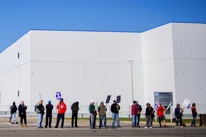 General Motors' Flint Assembly Plant employees line the street with picket signs during the nationwide UAW strike against General Motors on Monday, Oct. 7, 2019, in Flint, Mich. (Jake May/The Flint Journal via AP)