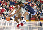 Villanova guard Bryan Antoine (1) and Saint Joseph's guard Rahmir Moore (10) chase a loose ball in the first half of an NCAA college basketball game, Saturday, Dec. 7, 2019, in Philadelphia. (AP Photo/Laurence Kesterson)