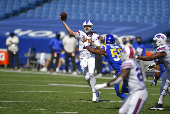 Buffalo Bills quarterback Josh Allen, left, throws a pass to running back Devin Singletary during the first half of an NFL football game Sunday, Sept. 27, 2020, in Orchard Park, N.Y. (AP Photo/Adrian Kraus)