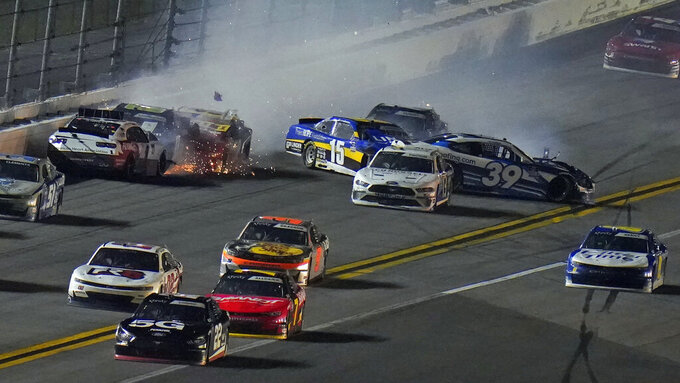 Michael Annett (1), Jeffrey Earnhardt (0), Gray Gaulding (52) Ryan Sieg (39) and Colby Howard (15) crash during a NASCAR Xfinity Series auto race Saturday, Feb. 13, 2021, at the Daytona International Speedway in Daytona Beach, Fla. (AP Photo/Chris O'Meara)