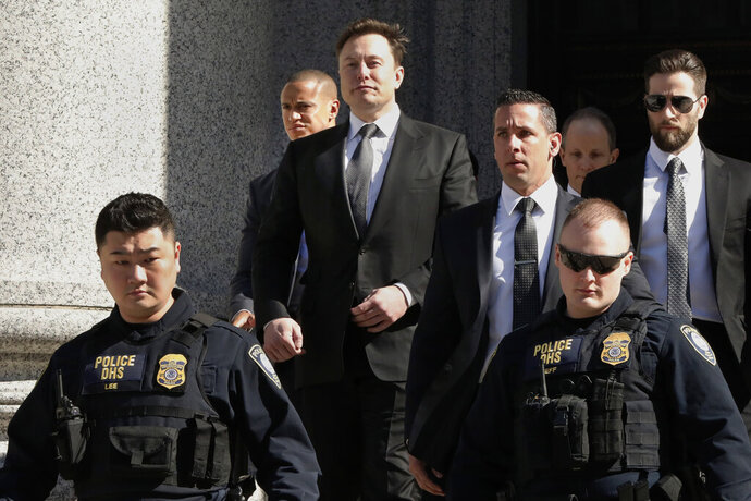 FILE - In this April 4, 2019, file photo, Tesla CEO Elon Musk leaves Manhattan Federal Court, in New York. In a letter filed on Thursday, April 18, 2019, lawyers for Musk and the U.S. government asked for another week to negotiate a deal to keep Musk from being found in contempt of court. (AP Photo/Richard Drew, File)