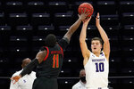 Northwestern forward Miller Kopp, right, shoots against Maryland guard Darryl Morsell during the second half of an NCAA college basketball game in Evanston, Ill., Wednesday, March 3, 2021. Northwestern won 60-55. (AP Photo/Nam Y. Huh)