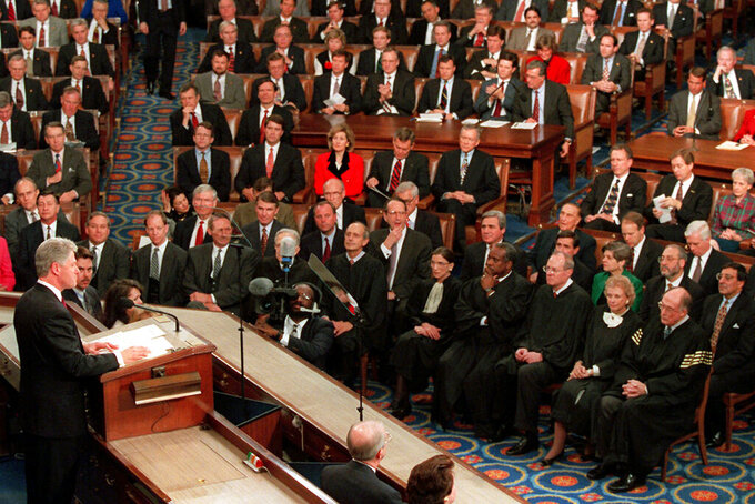 """FILE - In this Jan. 23, 1996, file photo, President Bill Clinton gestures while giving his State of the Union address to a joint session of Congress on Capitol Hill, in Washington. When he stood before Congress in 1996 and declared """"the era of big government is over,"""" Clinton gave voice to a doctrine that permeated Democratic politics for more than two decades. Government, while necessary, shouldn't be celebrated if the party wanted to win elections. The coronavirus is changing that. Democrats are enthusiastically embracing the idea of a robust role for government in American life, abandoning concerns they might alienate the relatively narrow slice of independent voters. (AP Photo/Greg Gibson, File)"""