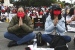 Myanmar nationals living in Taiwan pray for victims and express their disdain against the military regime in Myanmar during a demonstration at Liberty Square in Taipei, Taiwan, Sunday, March 21, 2021. (AP Photo/Chiang Ying-ying)