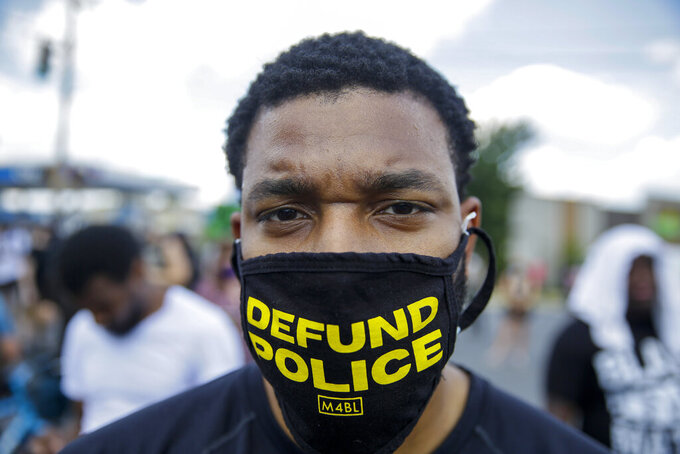 Arthur Williams, 31, of Atlanta protests on Saturday, June 13, 2020, near the Wendy's restaurant, in Atlanta, where Rayshard Brooks was fatally shot by police late Friday during a struggle following a field sobriety test. Authorities said the slain man had grabbed an officer's Taser, but was running away when he was shot. (AP Photo/Brynn Anderson)