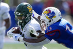 Baylor wide receiver Josh Fleeks (21) is tackled by Kansas cornerback Ra'Mello Dotson (13) during the first half of an NCAA college football game in Lawrence, Kan., Saturday, Sept. 18 2021. (AP Photo/Orlin Wagner)