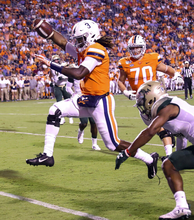 Virginia quarterback Bryce Perkins (3) runs for a touchdown next to William & Mary cornerback Corey Parker during the first half of an NCAA college football game in Charlottesville, Va., Friday, Sept. 6, 2019. (AP Photo/Andrew Shurtleff)