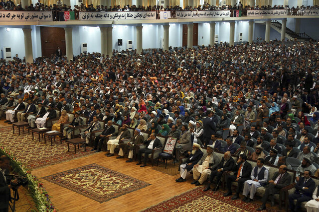 FILE - In this May 3, 2019 file photo, delegates attend the last day of the Afghan Loya Jirga meeting in Kabul, Afghanistan. Afghan officials said a traditional consultative council or Loya Jirga will convene Friday, Aug. 7, 2020, to decide whether the last 400 Taliban prisoners will be released as part of a peace agreement, even as its Health Ministry says half of Kabul's residents are infected with the coronavirus. The Taliban have rejected any changes to the deal they signed in February with the U.S. (AP Photo/Rahmat Gul, File)