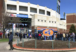 Fans lined up outside NBT Bank Stadium in Syracuse, N.Y., Thursday, April 4, 2019, as Tim Tebow is expected to play in the opening-day minor league baseball game with the Triple-A Syracuse Mets. The former Heisman Trophy winner and NFL quarterback is trying to make it to the major leagues with the New York Mets organization. (AP Photo/John Kekis