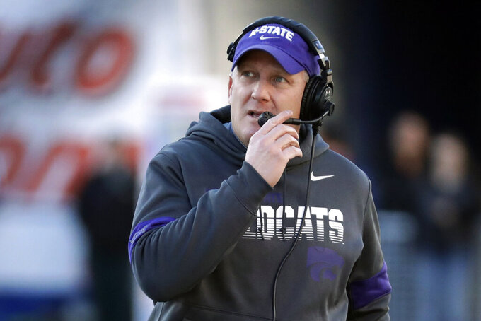 FILE - In this Dec. 31, 2019, file photo, Kansas State coach Chris Klieman watches from the sideline during the first half of the team's Liberty Bowl NCAA college football game against Navy in Memphis, Tenn. Kansas State is entering Year 2 under Klieman with a returning starter at quarterback, plenty of standouts on defense but a whole lot of questions. (AP Photo/Mark Humphrey, File)