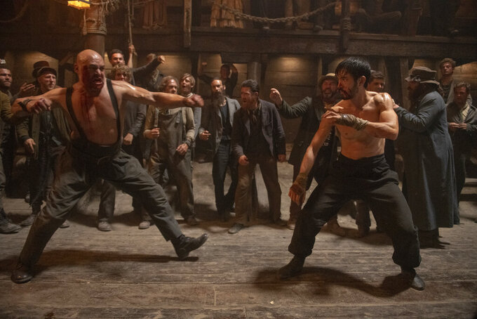 """This image released by Cinemax shows Andrew Koji, right, in a scene from the drama series """"Warrior.""""  The historical drama inspired by Bruce Lee's original idea, premieres its second season on Friday. (Cinemax via AP)"""