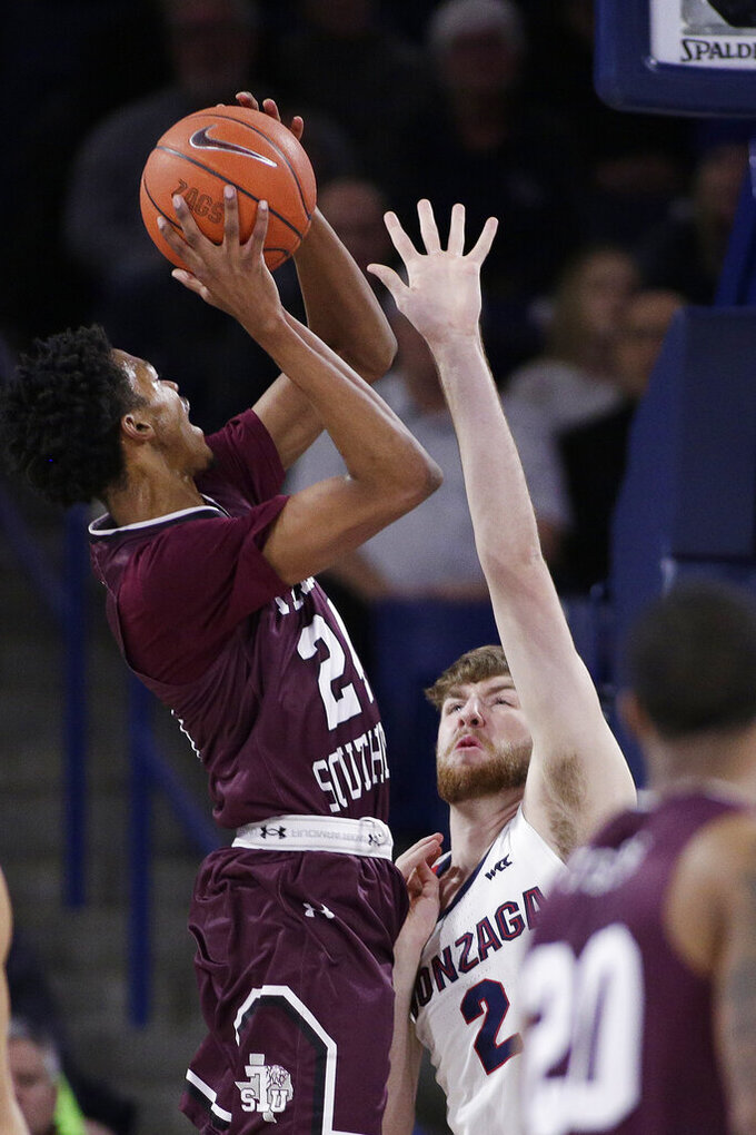 Texas Southern forward John Walker III, left, shoots over Gonzaga forward Drew Timme during the first half of an NCAA college basketball game in Spokane, Wash., Wednesday, Dec. 4, 2019. (AP Photo/Young Kwak)