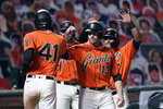 San Francisco Giants' Wilmer Flores (41) is congratulated by Austin Slater (13) and Donovan Solano, right, after hitting a three-run home run against the the San Diego Padres during the sixth inning of the second game of a baseball doubleheader Friday, Sept. 25, 2020, in San Francisco. (AP Photo/Tony Avelar)